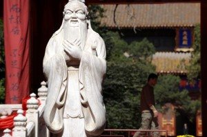 Statue of Confucius at the entrance of the Confucius Temple in Beijing, China